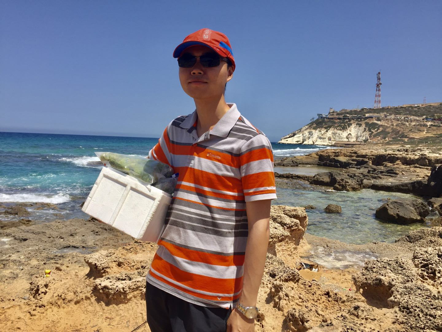 Image:  Jincheng Luo during algae research, at Rosh Hanikra, Israel